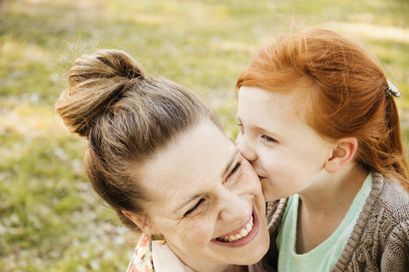 people: Portrait of smiling mid adult mother and daughter in park