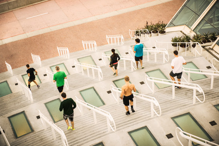 energy work: Group of runners training on convention center steps