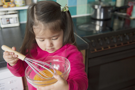 stovetop: Girl learning to cook