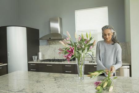 tallness: Woman arranging lilies