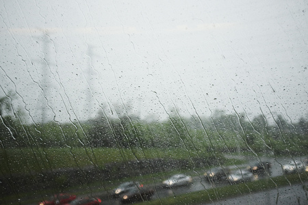 go inside: View through window of highway and traffic on a rainy day