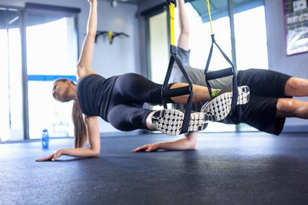 detoxing: Couple doing side plank exercise