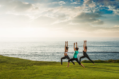 chillout: Women on cliff, in yoga position