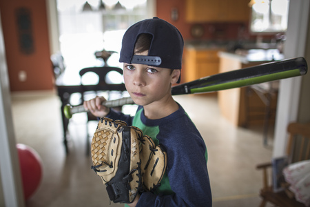 miserable: Portrait of boy baseball player with attitude LANG_EVOIMAGES