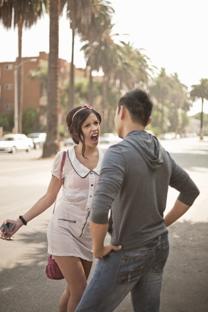 accusations: Couple arguing on suburban street LANG_EVOIMAGES