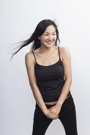 Studio portrait of mid adult woman
