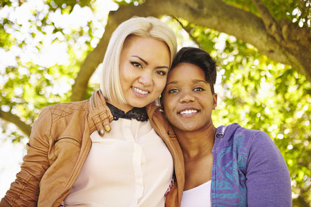 complicity: Portrait of lesbian couple in park