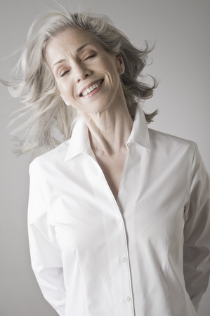 shutting: Mature woman smiling LANG_EVOIMAGES