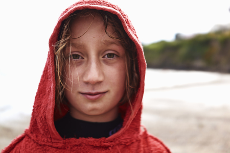 Portrait of girl in red hooded top