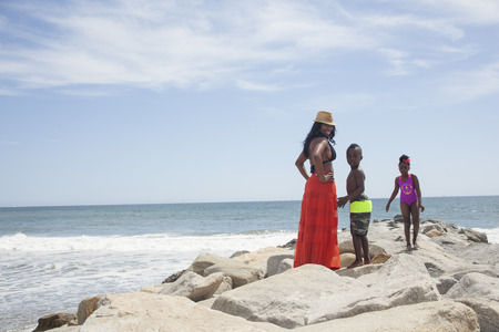 Mother and children enjoying ocean LANG_EVOIMAGES