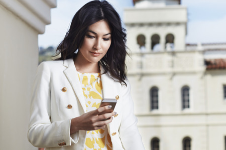 Young woman texting on smartphone