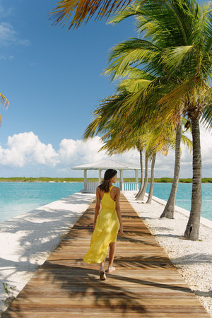 chillout: Young woman strolling on beach pier, Providenciales, Turks and Caicos Islands, Caribbean