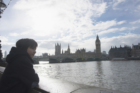 english ethnicity: Boy by River Thames, Palace of Westminster in background, London