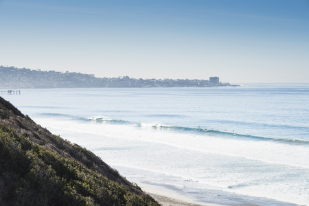 Distant view of surfers at sea, Black Beach, La Jolla, California, USA LANG_EVOIMAGES
