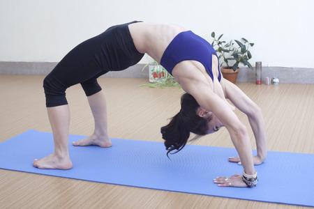 floor covering: Woman in bridge pose