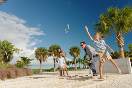 Family playing horseshoe game, Providenciales, Turks and Caicos Islands, Caribbean