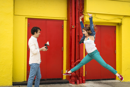 legs around: Couple having fun whilst taking photograph LANG_EVOIMAGES