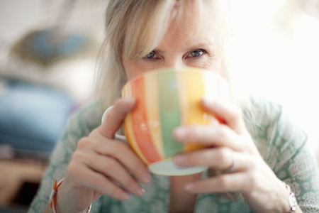 one mature woman only: Close up of mature woman drinking coffee