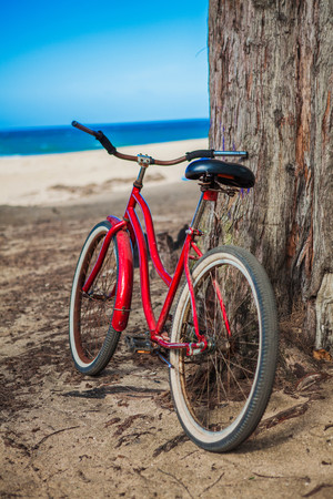 mode: Red bicycle parked on beach, Kauai, Hawaii, USA