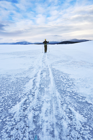 vacant land: Mid adult woman skiing across vast landscape, Colter Bay, Wyoming, USA LANG_EVOIMAGES