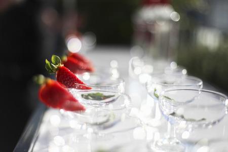 Strawberry slice on cocktail glasses