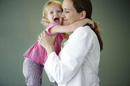 embraced: Girl hugging paediatrician
