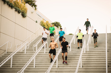 Small group of runners training on convention center stairs