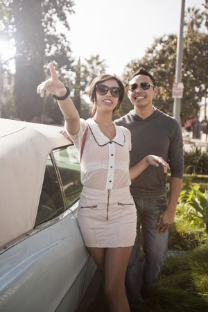 Couple with convertible car LANG_EVOIMAGES