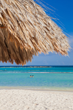 refreshed: Two people swimming off Palm Beach, Aruba, Lesser Antilles, Caribbean