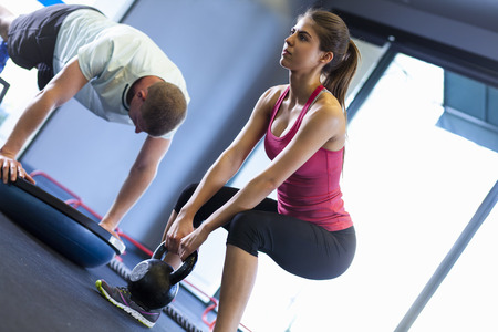 Couple working out in gym LANG_EVOIMAGES