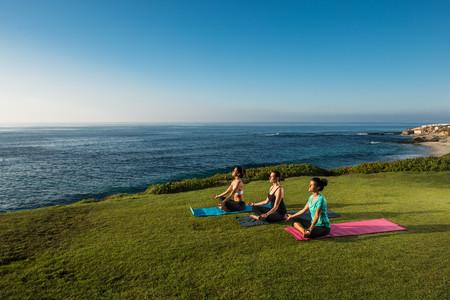 Women on cliff, meditating
