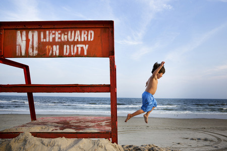 trouble free: Boys jumping mid air, Long Beach, New York State, USA