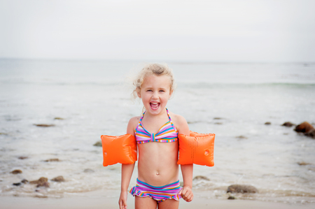 armbands: Young girl with armbands on the beach