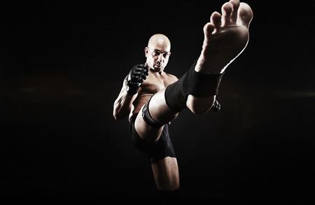 Mature man kickboxing