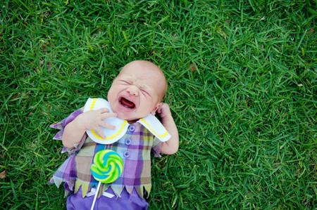 checker: Baby lying on grass, crying