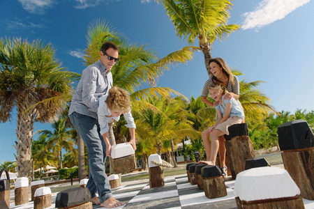 silliness: Family playing giant chess, Providenciales, Turks and Caicos Islands, Caribbean
