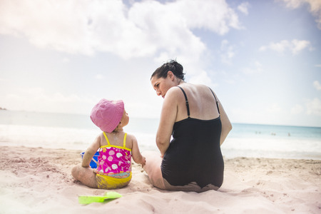Mother and daughter by seaside