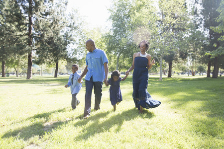 6 7 year old: Mature couple with son and daughter strolling in park