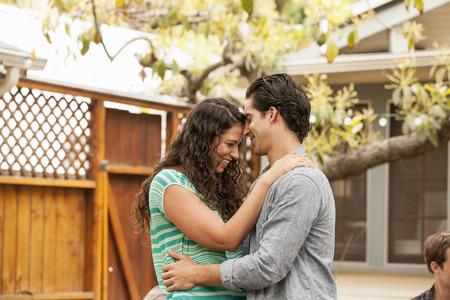 Couple in garden, face to face