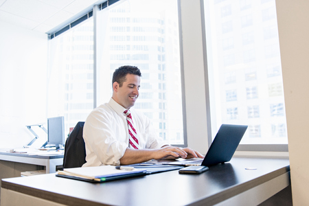 solicitors: Business lawyer using laptop in office LANG_EVOIMAGES