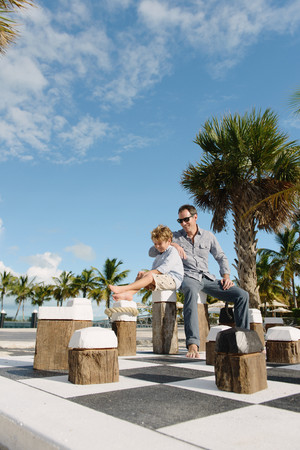 chillout: Father and son sitting on giant chess set, Providenciales, Turks and Caicos Islands, Caribbean