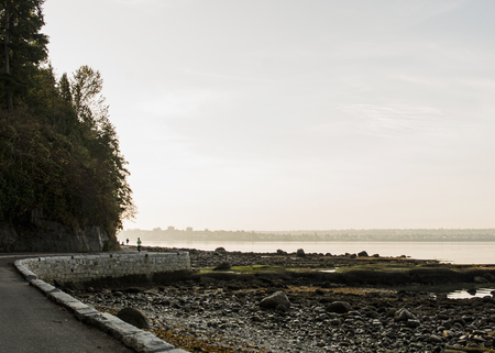 negative area: Solitary runner on waterfront road, Vancouver, Canada