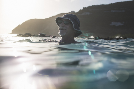 submerging: Senior man swimming in the sea LANG_EVOIMAGES