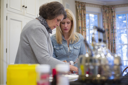 Senior woman and granddaughter baking together