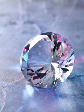 Diamond on piece of granite, close-up LANG_EVOIMAGES