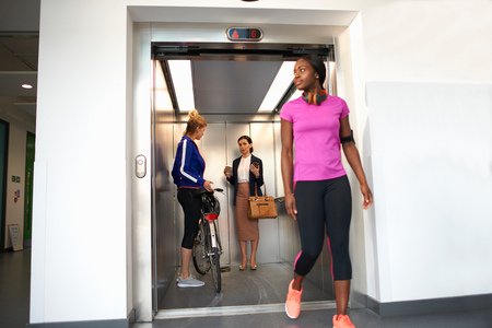 thrifty: Female colleagues taking office lift