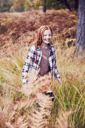 Portrait of young girl in rural setting LANG_EVOIMAGES