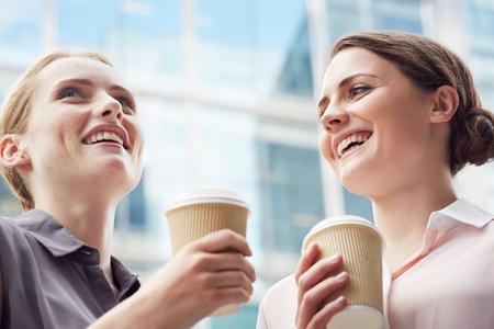 Business women having coffee break, London, UK LANG_EVOIMAGES