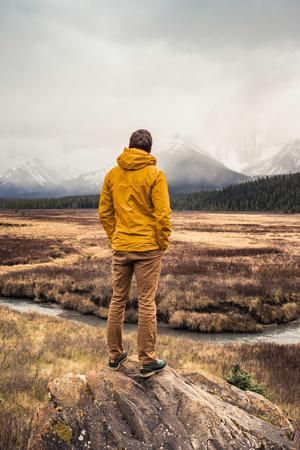 Man standing, looking at view, rear view, Kananaskis Country, Bow Valley Provincial Park, Kananaskis, Alberta, Canada LANG_EVOIMAGES