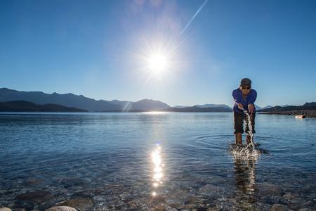 Woman trying the water at Nahuel Huapi Lake in Patagonia